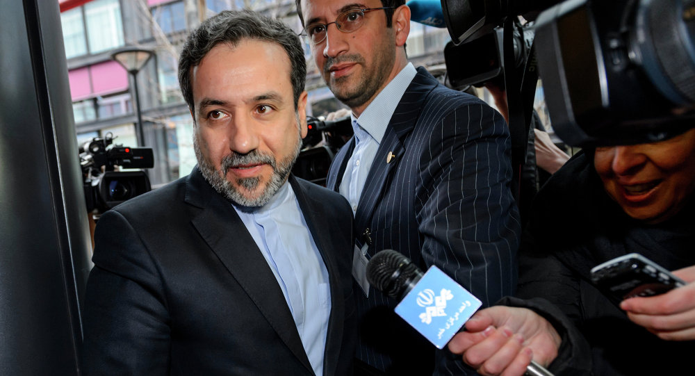 Iranian Deputy Foreign Minister Abbas Araqchi enters the mission of the European Union building on December 17, 2014 in Geneva