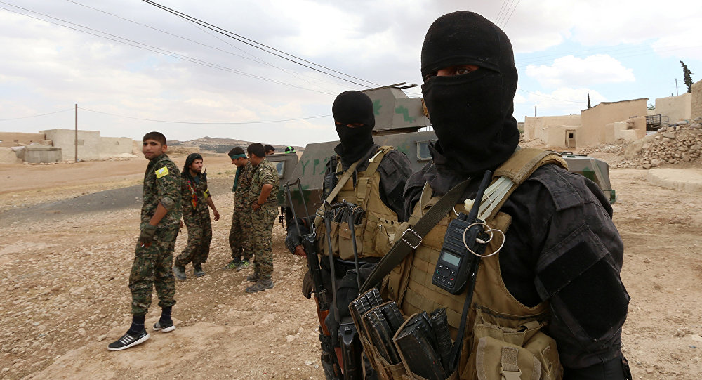 Special forces from the Syria Democratic Forces gather in Haj Hussein village, after taking control of it from Islamic State fighters, in the southern rural area of Manbij, in Aleppo Governorate, Syria May 31, 2016
