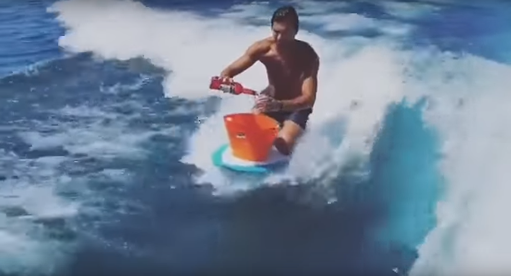 Guy Makes Cocktails While Wake Surfing