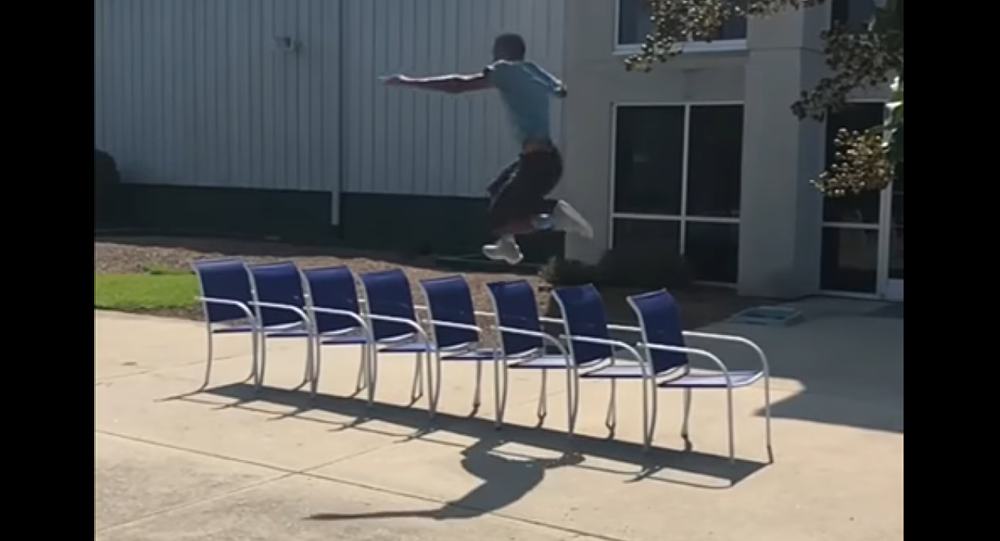 Guy Leaps Over Chairs