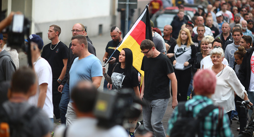 People attend a right wing protest in Koethen, Germany, September 9, 2018, after a 22-year-old German man died overnight in the eastern town of Koethen and two Afghans have been detained on suspicion of killing him.