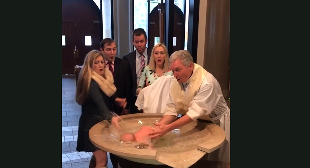 US Priest's Baptismal Blunder Causes Baby to Fall Face-First